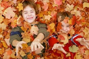 Kids in leaves - Compressed